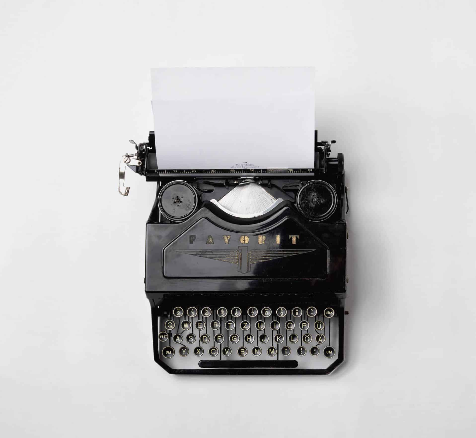 Old black typewriter on white background