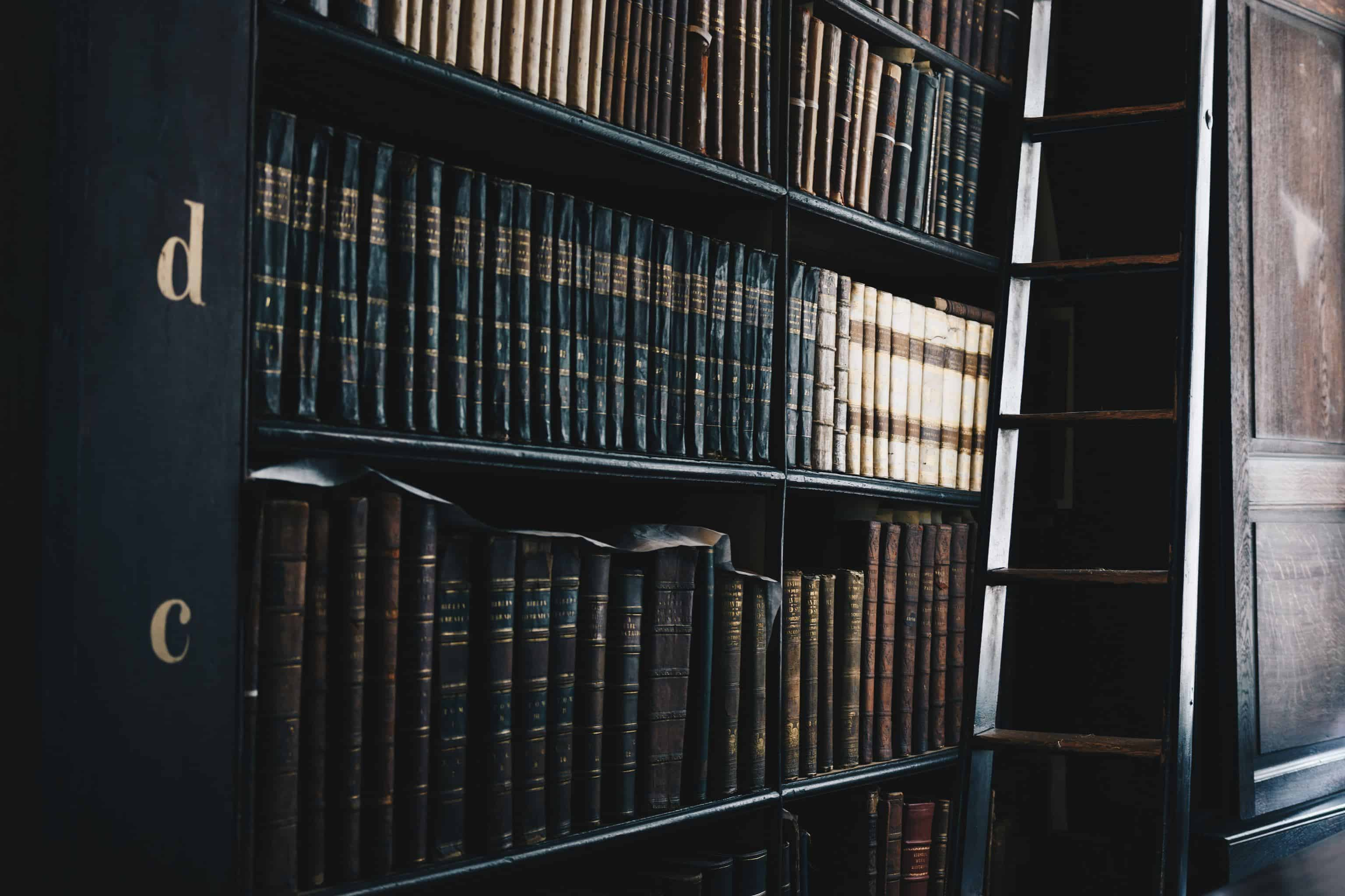 Shelf with books as a symbol for legal texts and jurisprudence