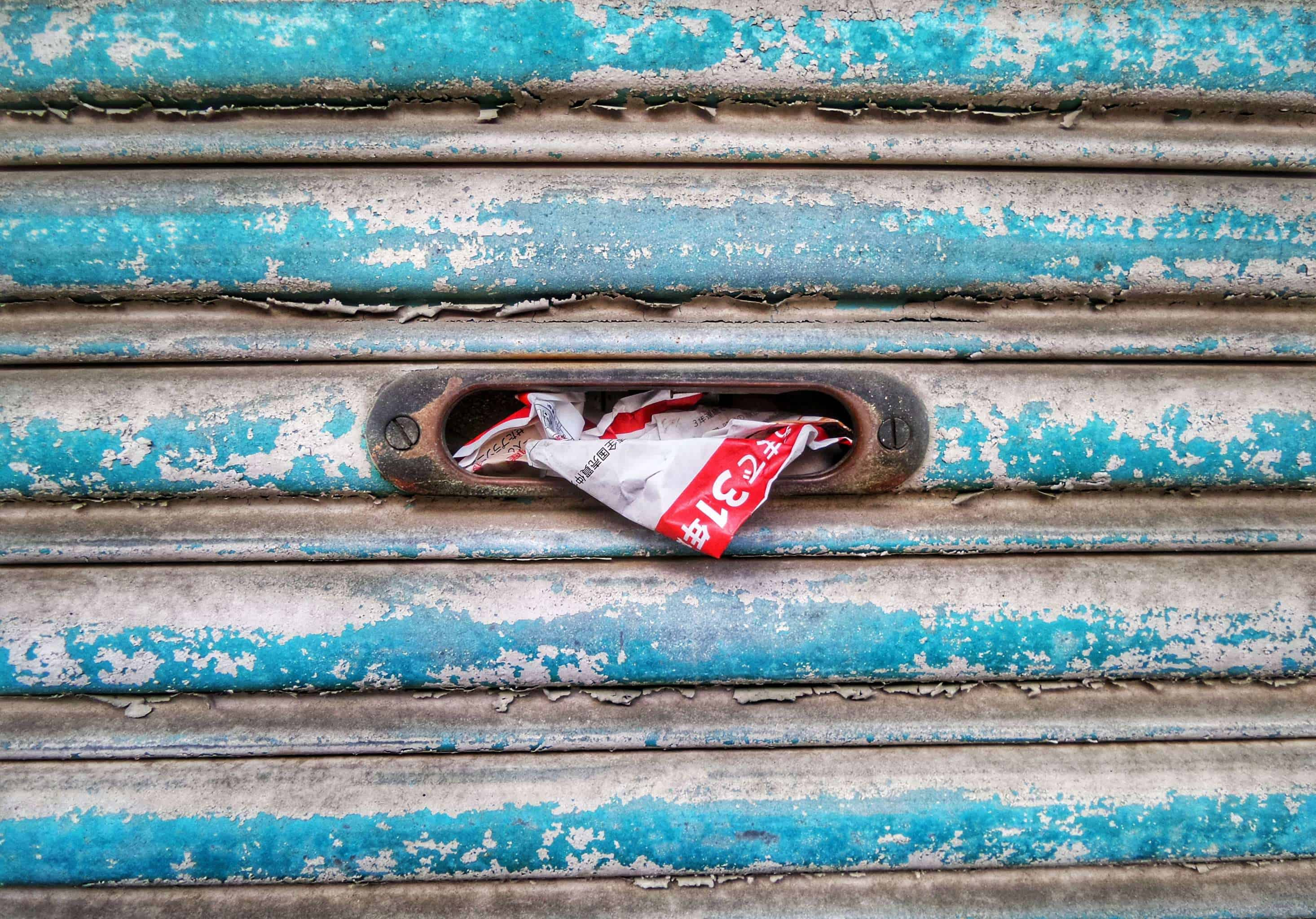 Crumpled advertising mail in a mailbox
