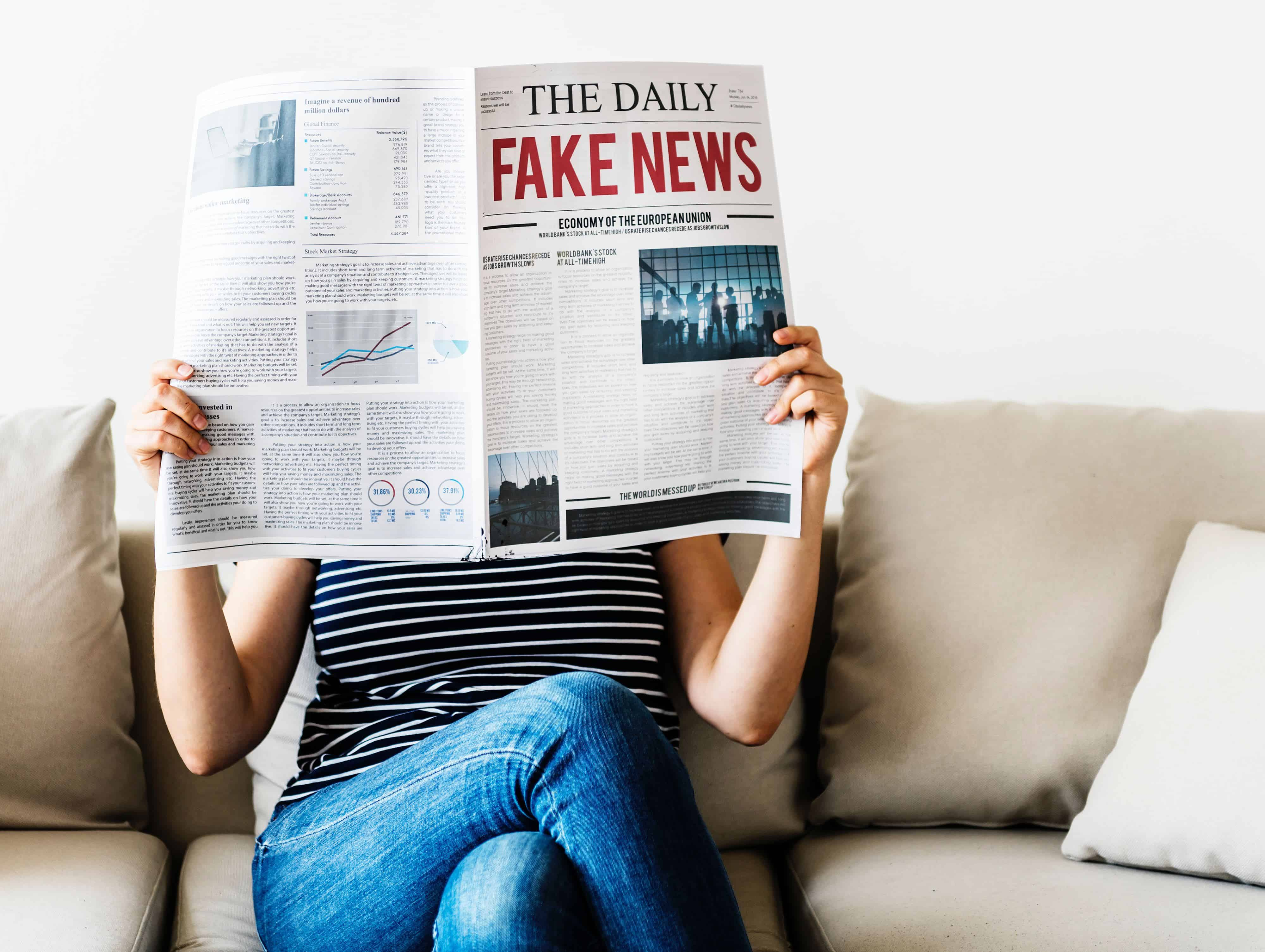 Woman with newspaper, title: The Daily Fake News